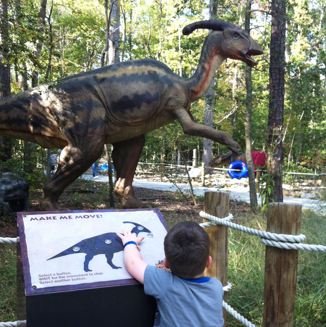 Several of the dinos had buttons kids could push to make them move and roar. JJ was VERY impressed.